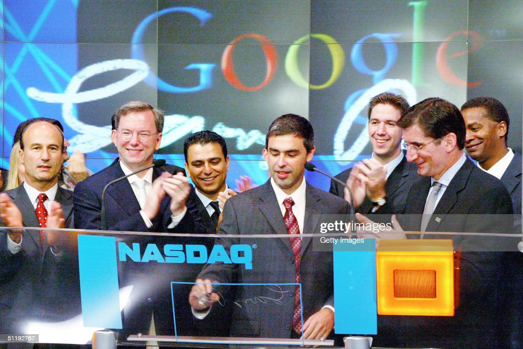 Google CFO George Reyes, Chairman of the Executive Committee and CEO Eric E. Schmidt, SVP Worldwide Sales & Field Operations Omid Kordestani, Co-Founder and President of Products Larry Page, NASDAQ President and CEO Robert Greifeld and Google Vice President for Corporate Development David Drummond participate in a ceremony as Google, Inc. is listed on the NASDAQ stock exchange for the first time August 19, 2004 in New York City.