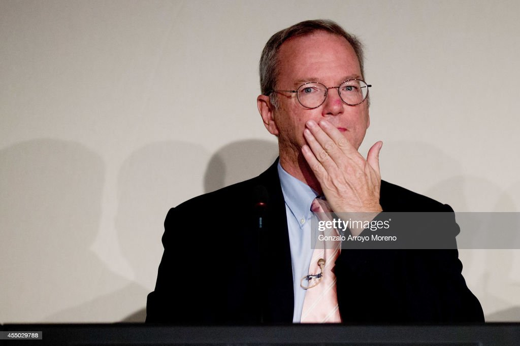 Google Chairman Eric Schmidt cover his mouth during an advisory council about The Right to be Forgotten at Casa de America on September 9, 2014 in Madrid, Spain. Google is holding a series of meetings across Europe to discuss the European Court of Justice's 'right to be forgotten' ruling, which allows individuals to request Google remove information about them.