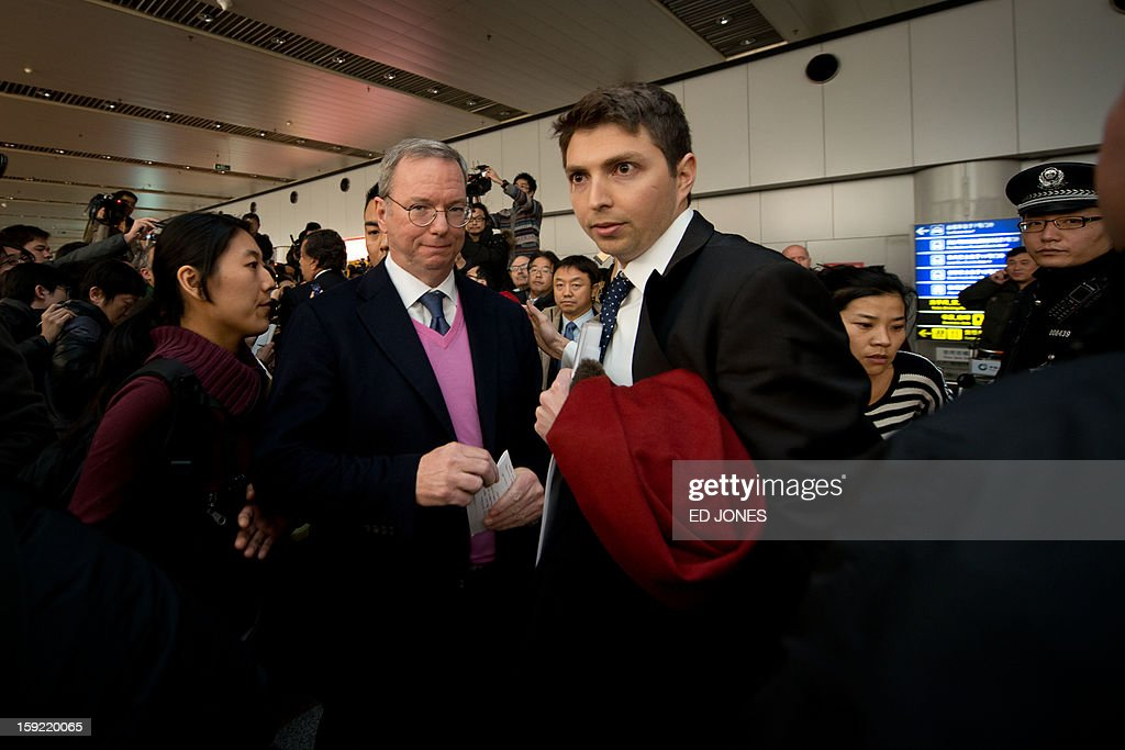 Google chairman Eric Schmidt (2nd L) is surrounded by the media after arriving at Beijing airport from North Korea on January 10, 2013 with former New Mexico governor Bill Richardson (not pictured). Richardson and Schmidt met with reporters following their visit to secretive North Korea calling for greater Internet freedom for the welfare of its people. AFP PHOTO / Ed Jones