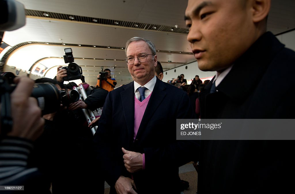 Google chairman Eric Schmidt (C) leaves after talking to the media with former New Mexico governor Bill Richardson (not pictured) upon arriving at Beijing airport from North Korea on January 10, 2013. Richardson and Schmidt met with reporters following their visit to secretive North Korea calling for greater internet freedom for the welfare of its people. AFP PHOTO / Ed Jones