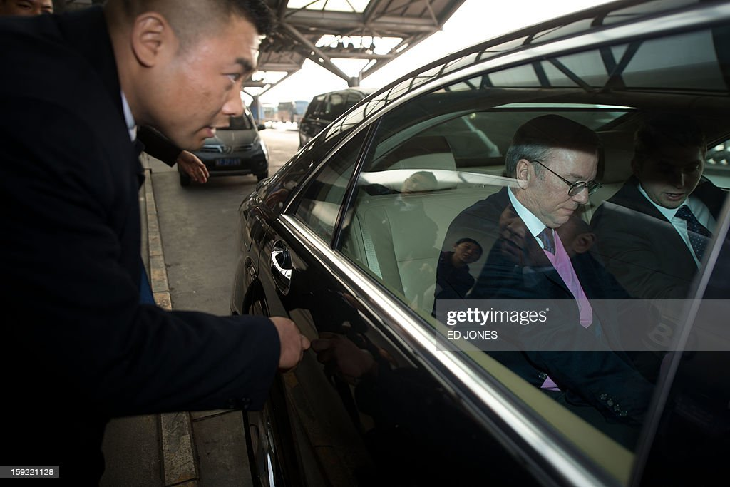 Google chairman Eric Schmidt (C) sits in a car as he leaves Beijing airport upon his arrival from North Korea on January 10, 2013. Former New Mexico governor Bill Richardson and Schmidt met with reporters following their visit to secretive North Korea calling for greater internet freedom for the welfare of its people. AFP PHOTO / Ed Jones