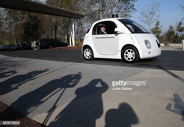 Google Chairman Eric Schmidt sits in a Google selfdriving car at the Google headquarters on February 2 2015 in Mountain View California US...