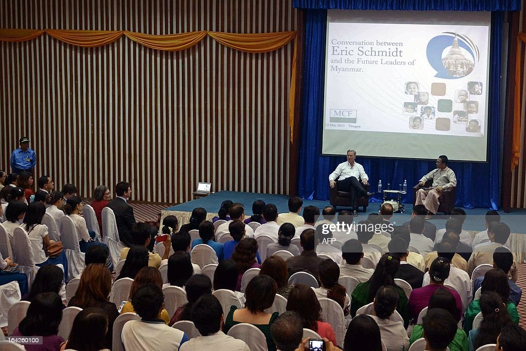 Google chairman Eric Schmidt (2nd R, on stage) speaks during a conference at a technology park in Yangon on March 22, 2013. Schmidt's stop in Myanmar is part of a tour of Asia which also took him to North Korea in January. AFP PHOTO/Ye Aung THU