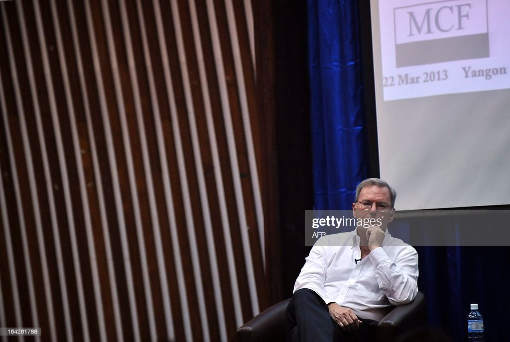 Google chairman Eric Schmidt takes part in a conference at a technology park in Yangon on March 22, 2013. Schmidt's stop in Myanmar is part of a tour of Asia which also took him to North Korea in January. AFP PHOTO/Ye Aung THU