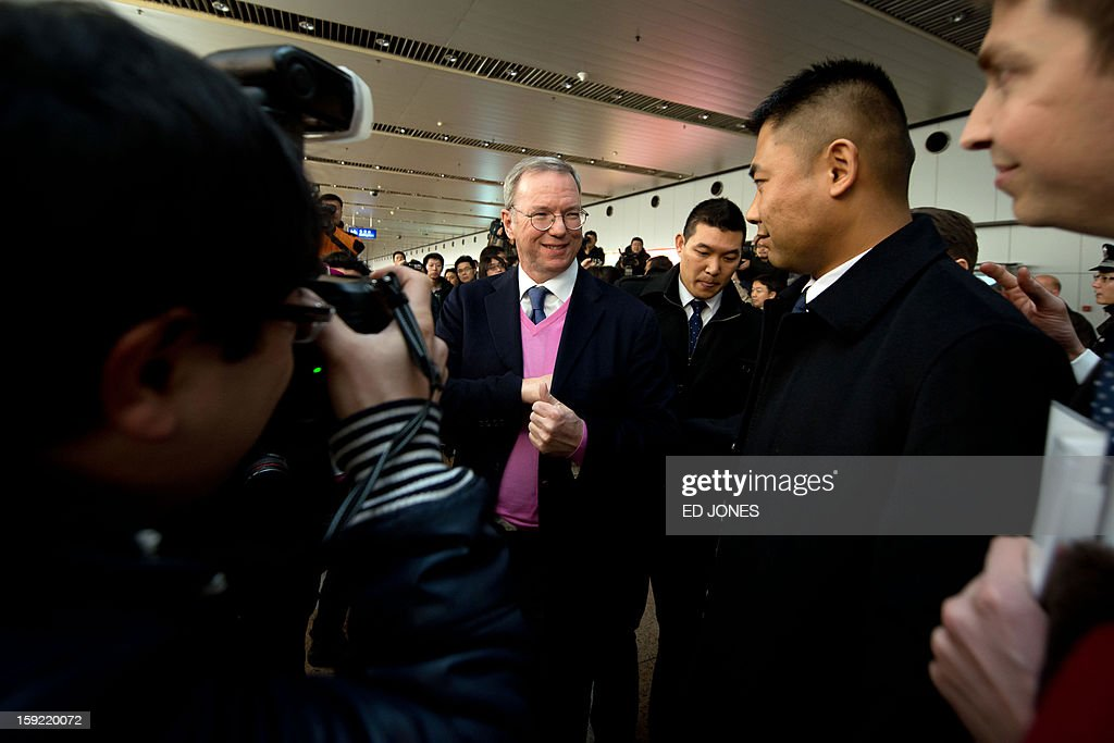 Google chairman Eric Schmidt (C) talks to the media after arriving at Beijing airport from North Korea on January 10, 2013 with former New Mexico governor Bill Richardson (not pictured). Richardson and Schmidt met with reporters following their visit to secretive North Korea calling for greater Internet freedom for the welfare of its people. AFP PHOTO / Ed Jones