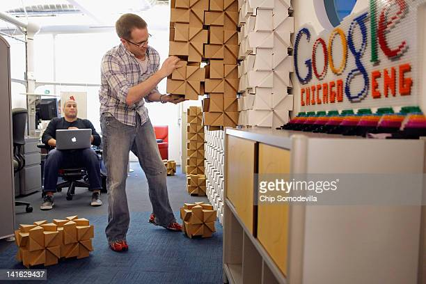 Google Chicago engineer builds a wall from Bloxes cardboard blocks headquarters March 20 2012 in Chicago Illinois Republican presidential candidate...