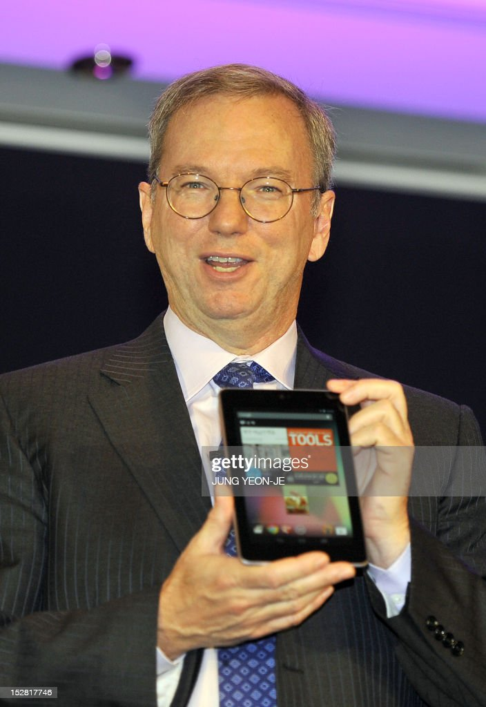 Google chief executive Eric Schmidt shows its new tablet PC, Nexus 7, during a news conference in Seoul on September 27, 2012. Schmidt criticised raging patent disputes in the global mobile industry, accusing them of stifling innovation and preventing choices for consumers. AFP PHOTO/JUNG YEON-JE