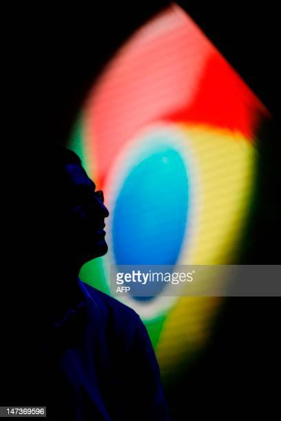 A Google Chrome logo is seen behind Sundar Pichai senior vice president of Chrome during the Chrome keynote at Google's annual developer conference...