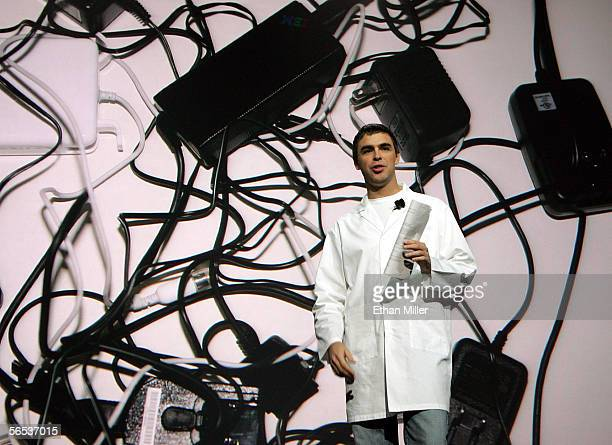 Google cofounder Larry Page stands in front of an image of jumbled adapters and power cords as he delivers a keynote address at the International...