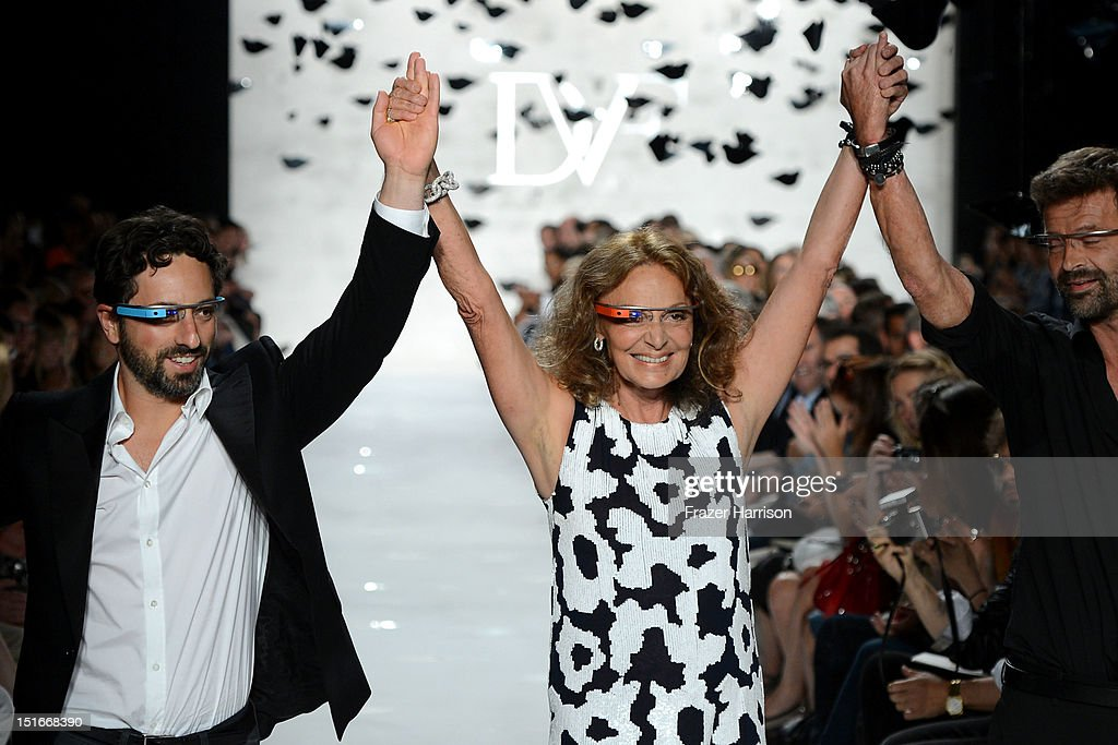 Google co-founder <a gi-track='captionPersonalityLinkClicked' href=/galleries/search?phrase=Sergey+Brin&family=editorial&specificpeople=753551 ng-click='$event.stopPropagation()'>Sergey Brin</a>, and designers Diane Von Furstenberg and Yvan Mispelaere walk the runway at the Diane Von Furstenberg Spring 2013 fashion show during Mercedes-Benz Fashion Week at The Theatre at Lincoln Center on September 9, 2012 in New York City.