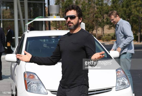 Google cofounder Sergey Brin stands in front of a selfdriving car at the Google headquarters on September 25 2012 in Mountain View California...