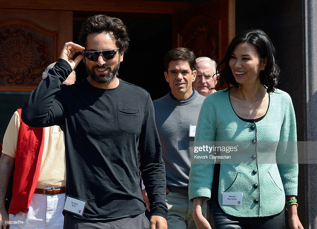 Google co-founder Sergey Brin (L) wearing a Project Glass prototype glasses and Wendi Murdoch attend Allen & Company's Sun Valley Conference on July 12, 2012 in Sun Valley, Idaho. Since 1983, the investment firm Allen & Company has annually hosted the media and technology conference which is usually attended by powerful media executives.