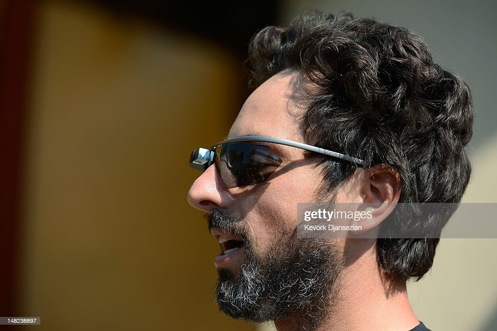 Google co-founder Sergey Brin (L) wears Project Glass prototype glasses at Allen & Company's Sun Valley Conference on July 12, 2012 in Sun Valley, Idaho. Since 1983, the investment firm Allen & Company has annually hosted the media and technology conference which is usually attended by powerful media executives.
