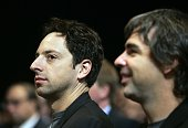 Google cofounders Sergey Brin and Larry Page appear in the audience at the Clinton Global Initiative annual meeting on September 22 2006 in New York...