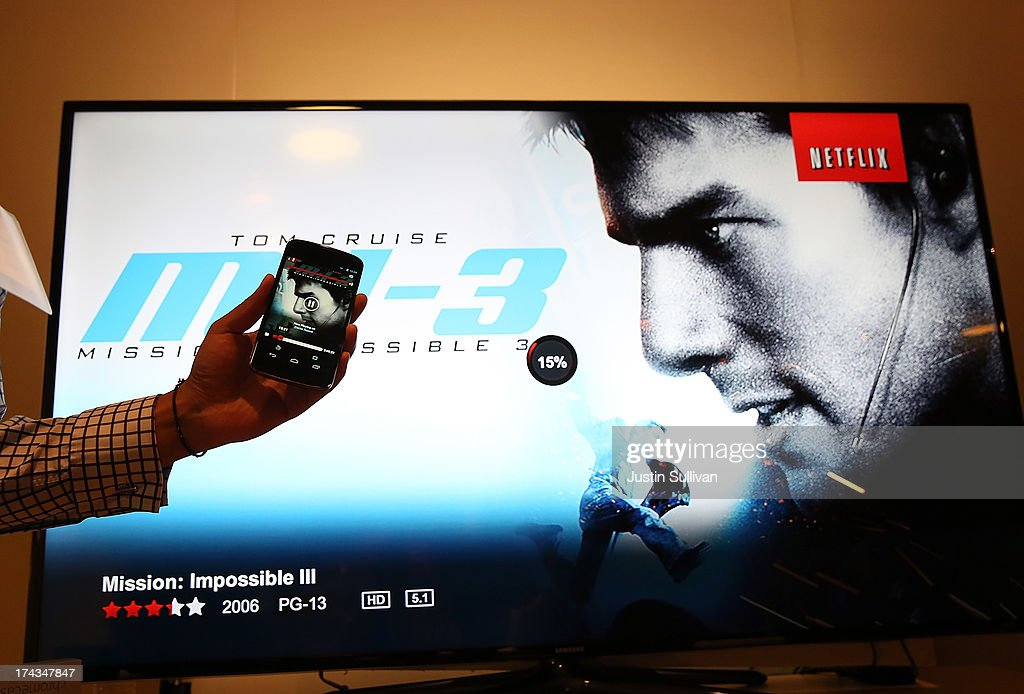 A Google employee demonstrates playing a video on a phone and transferring it to a television using the new Google Chromecast SDK during a Google special event at Dogpatch Studios on July 24, 2013 in San Francisco, California. Google announced a new Nexus 7 tablet made by Asus and the Chromecast SDK.