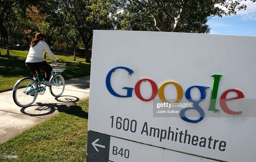 A Google employee rides a bicycle by a sign at the company's headquarters October 18, 2007 in Mountain View, California. Google reported today that third quarter profits surged 46 percent to $1.07 billion, or $3.38 per share, compared to $733.4 million, or $2.36 per share one year ago.