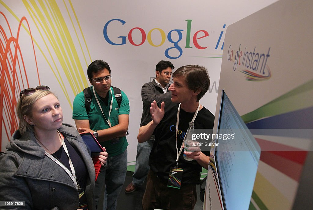 Google employee Shane Antos (R) gives a demonstration of the new Google Instant during a special launch event September 8, 2010 in San Francisco, California. Google announced the launch of Google Instant, a faster version of Google search that streams results live as you type your query.