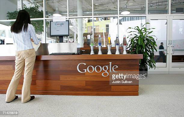 Google employee stands in a lobby at the Googleplex May 11 2006 in Mountain View California
