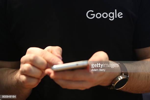 Google employee uses a mobile phone on December 11 2015 in Berlin Germany The company which provides its namesake search engine as well as other...