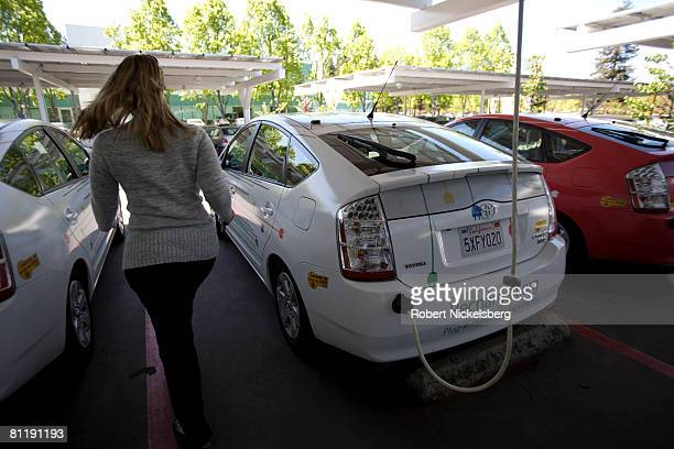 Google employee walks around one of the many electric cars owned and leased by the company on April 15 2008 in Mountain View California The electric...