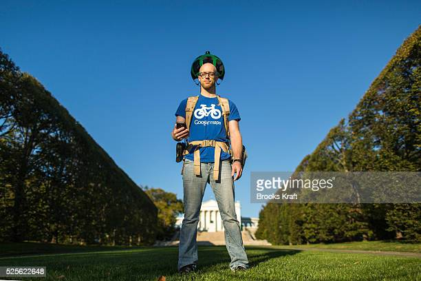 A Google employee walks thru Arlington National Cemetery with the Street View capture device known as the Trekker a wearable backpack system that has...