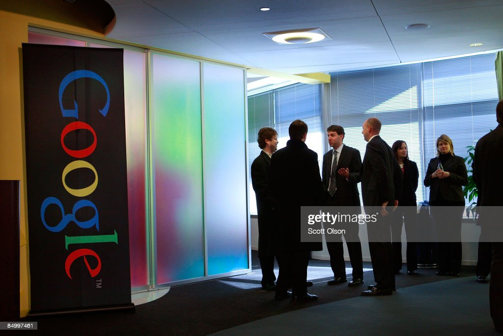 Google employees wait for the start of a press conference with Chicago Mayor Richard M. Daley at the Google Chicago office February 23, 2009 in Chicago, Illinois. The mayor was at the office to help launch his YouTube channel.