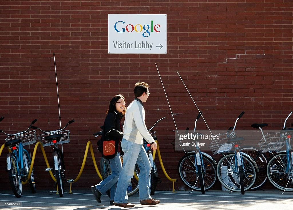 Google employees walk by a row of communal bicycles at the company's headquarters October 18, 2007 in Mountain View, California. Google reported today that third quarter profits surged 46 percent to $1.07 billion, or $3.38 per share, compared to $733.4 million, or $2.36 per share one year ago.