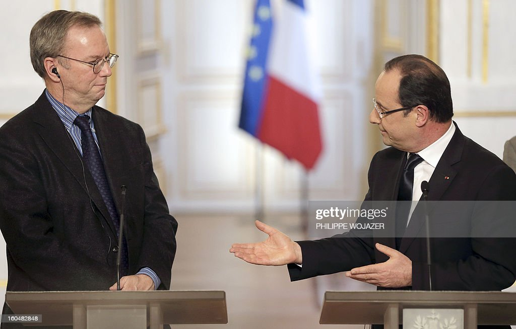 Google Executive Chairman Eric Schmidt and French President Francois Hollande give a press conference following a signing agreement meeting at the Elysee Presidential Palace on February 1, 2013 in Paris. AFP PHOTO / POOL / PHILIPPE WOJAZER