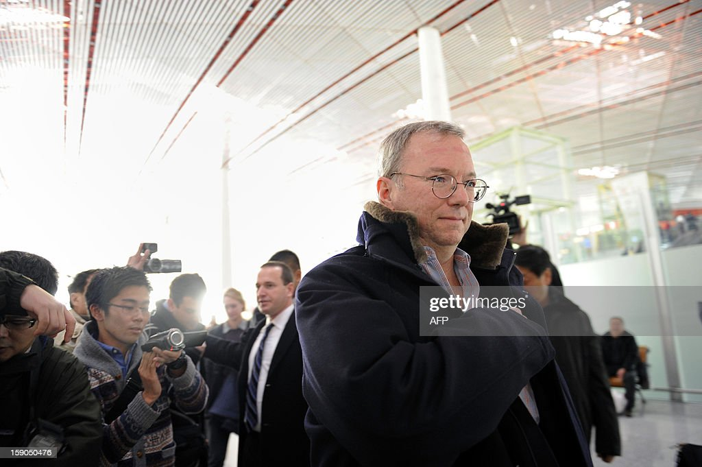 Google Executive Chairman Eric Schmidt (C) makes his way after checking in at Beijing International airport in Beijing on January 7, 2013, before his trip to North Korea. Former New Mexico governor Bill Richardson and Google chairman Eric Schmidt will head to North Korea on a 'private humanitarian mission,' Richardson's office said on January 5, 2012. AFP PHOTO / WANG ZHAO