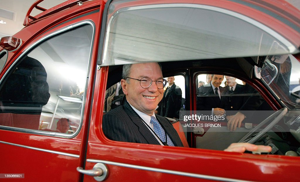 Google executive chairman Eric Schmidt sits in a Citroen 2CV car oldtimer during the inauguration of the new offices of Google France in Paris on December 6, 2011.