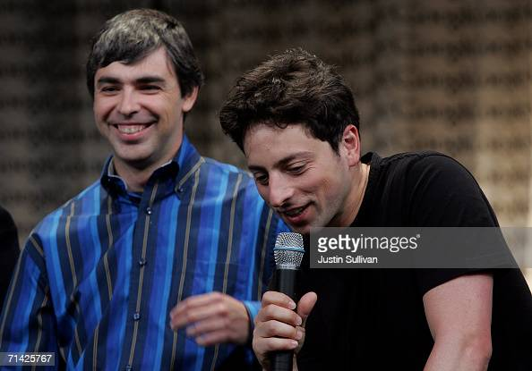 Google founders Larry Page Sergey Brin talk with members of the media at Google Press Day 2006 May 10 2006 in Mountain View California