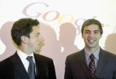 Google founders Sergey Brin and Larry Page joke prior to a news conference during the opening of the Frankfurt bookfair on October 7 2004 in...