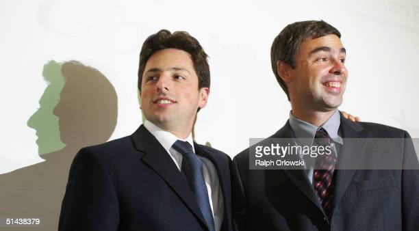 Google founders Sergey Brin and Larry Page smile prior to a news conference during the opening of the Frankfurt bookfair on October 7 2004 in...