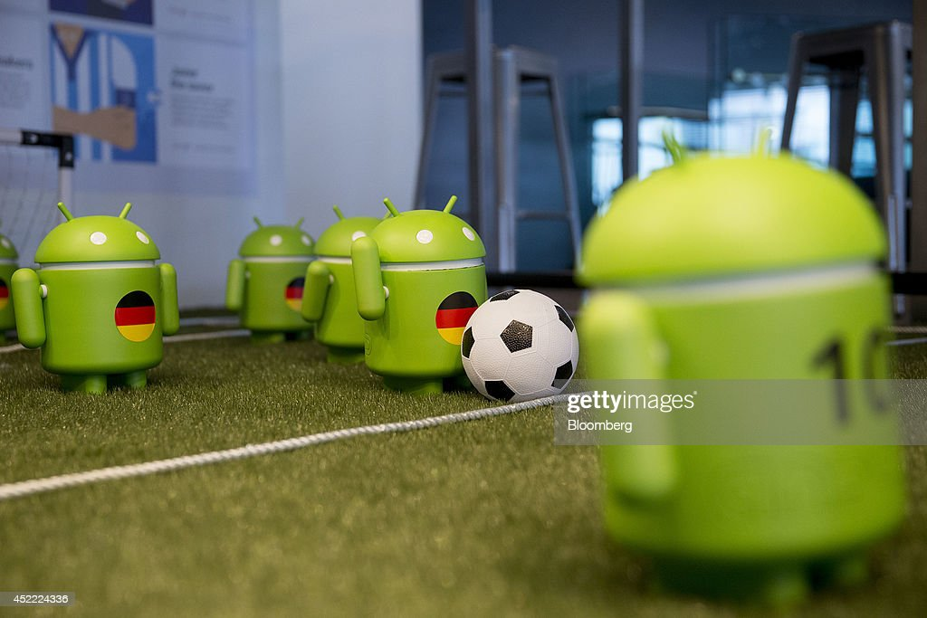 Google Inc. Android figures with the colors of the German flag are displayed on a model soccer field at the Google office in Washington, D.C., U.S., on Tuesday, July 15, 2014. Google's presence in Washington is necessitated in part by the Federal Trade Commission and U.S. Justice Department inquiries into how the company obtains and uses private data. Additional privacy and safety concerns are likely to arise from Google projects in the works, including nose-mounted Google Glass computers and self-driving cars. Photographer: Andrew Harrer/Bloomberg via Getty Images