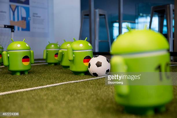 Google Inc Android figures with the colors of the German flag are displayed on a model soccer field at the Google office in Washington DC US on...