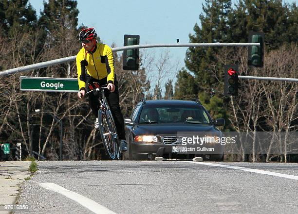 Google Inc cofounder Sergey Brin rides his bike by a sign outside of the Google headquarters March 10 2010 in Mountain View California Google...