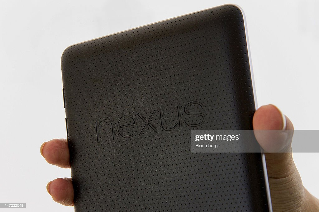 Google Inc. employee Cheryl Pon displays the new Nexus 7 tablet for a photograph during the Google I/O conference in San Francisco, California, U.S., on Wednesday, June 27, 2012. Google Inc. unveiled a $199 handheld computer called the Nexus 7 that features a 7-inch screen and is designed to help the company vie with Apple Inc., Microsoft Corp. and Amazon.com Inc. in the surging market for tablets. Photographer: David Paul Morris/Bloomberg via Getty Images