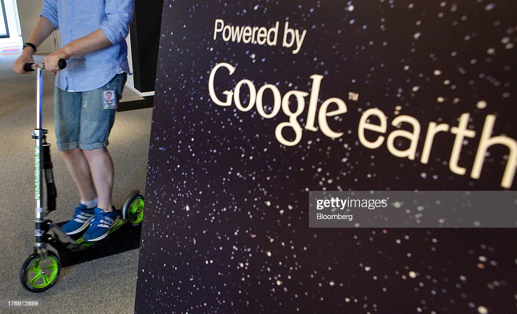 A Google Inc. employee uses a scooter as he moves around the company's offices in Berlin, Germany, on Friday, Aug. 16, 2013. Google, based in Mountain View, California, is seeking to revive Motorola Mobility's smartphone business, recently announcing a new flagship Moto X smartphone with customizable colors that will be assembled in the U.S. Photographer: Krisztian Bocsi/Bloomberg via Getty Images