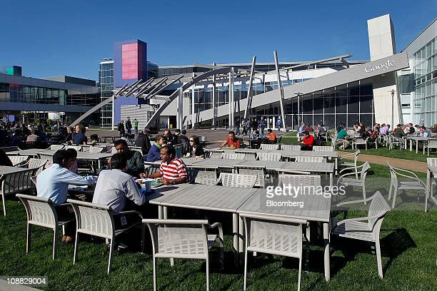 Google Inc employees sit outside during lunch time at company's headquarters in Mountain View California US on Wednesday Feb 2 2011 Google the...