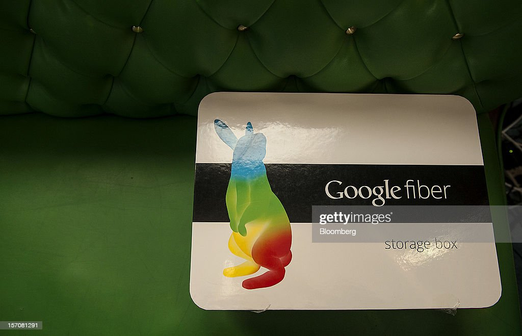 A Google Inc. Fiber broadband network installation box sits on a couch at the home of customer Becki Sherwood in Kansas City, Kansas, U.S., on Tuesday, Nov. 27, 2012. Google Inc. will move a step closer to offering the fastest citywide Internet service in the U.S. when it picks the first neighborhoods in Kansas City to get hooked into a new fiber-optic network. Photographer: Julie Denesha/Bloomberg via Getty Images