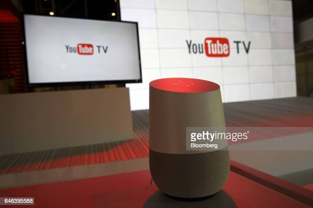 A Google Inc Home device is displayed in front of YouTube Inc signage during the company's unveiling of a new television subscription service at the...