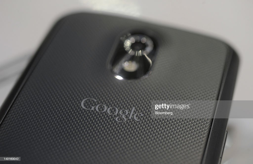 A Google Inc. logo sits near the camera lens on the reverse of a Samsung Electronics Co. Galaxy Nexus smartphone at the Mobile World Congress in Barcelona, Spain, on Wednesday, Feb. 29, 2012. The Mobile World Congress, operated by the GSMA, expects 60,000 visitors and 1400 companies to attend the four-day technology industry event which runs Feb. 27 through March 1. Photographer: Denis Doyle/Bloomberg via Getty Images