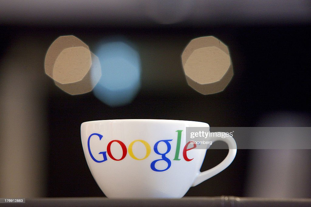 A Google Inc. logo sits on a coffee cup inside the company's offices in Berlin, Germany, on Friday, Aug. 16, 2013. Google, based in Mountain View, California, is seeking to revive Motorola Mobility's smartphone business, recently announcing a new flagship Moto X smartphone with customizable colors that will be assembled in the U.S. Photographer: Krisztian Bocsi/Bloomberg via Getty Images