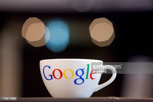A Google Inc logo sits on a coffee cup inside the company's offices in Berlin Germany on Friday Aug 16 2013 Google based in Mountain View California...
