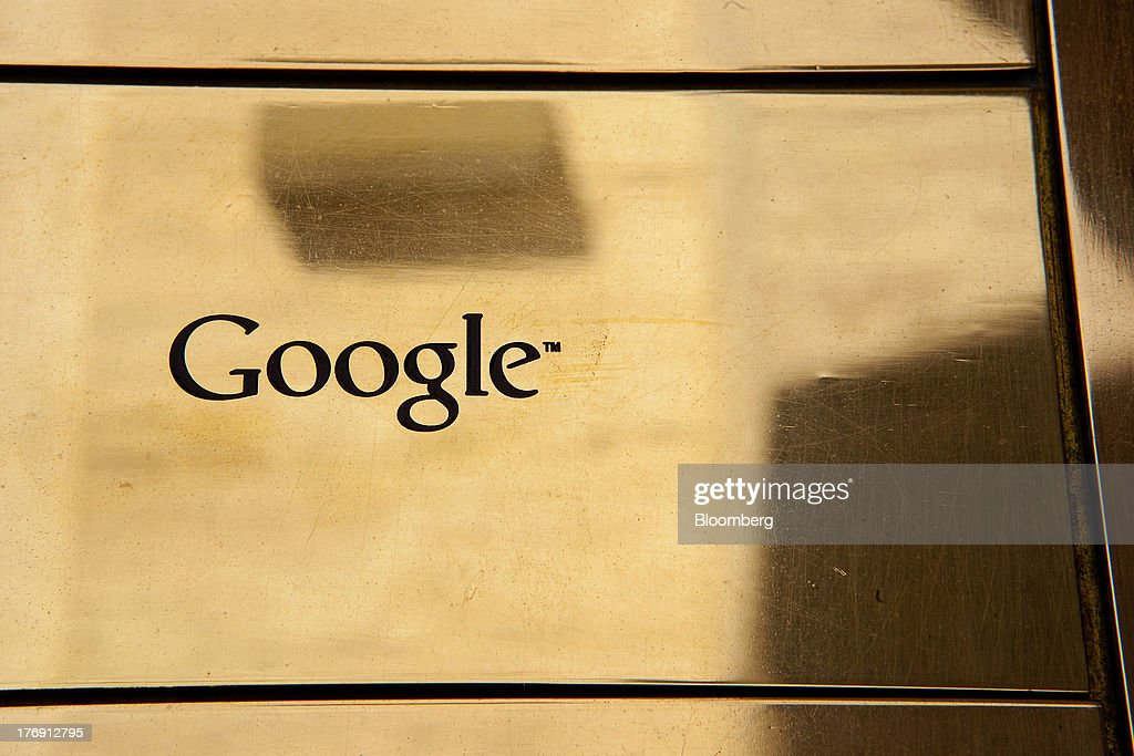A Google Inc. logo sits on a gold colored plaque outside the company's offices in Berlin, Germany, on Friday, Aug. 16, 2013. Google, based in Mountain View, California, is seeking to revive Motorola Mobility's smartphone business, recently announcing a new flagship Moto X smartphone with customizable colors that will be assembled in the U.S. Photographer: Krisztian Bocsi/Bloomberg via Getty Images