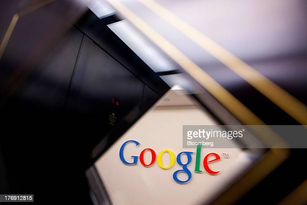 A Google Inc logo sits on a wall outside the entrance to the company's offices in Berlin Germany on Friday Aug 16 2013 Google based in Mountain View...