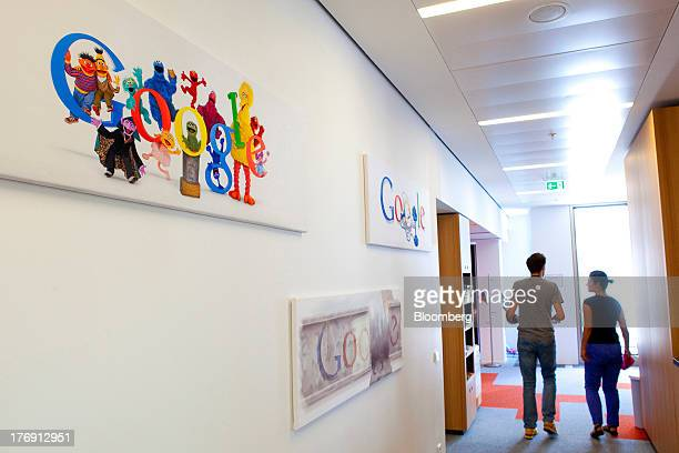 Google Inc logos sit on a wall inside the pantry at the company's offices in Berlin Germany on Friday Aug 16 2013 Google based in Mountain View...