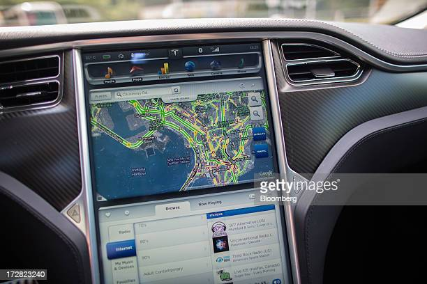 A Google Inc map is displayed on a screen in a Tesla Motors Inc Model S sedan electric vehicle parked in the area of Cyberport in Hong Kong China on...