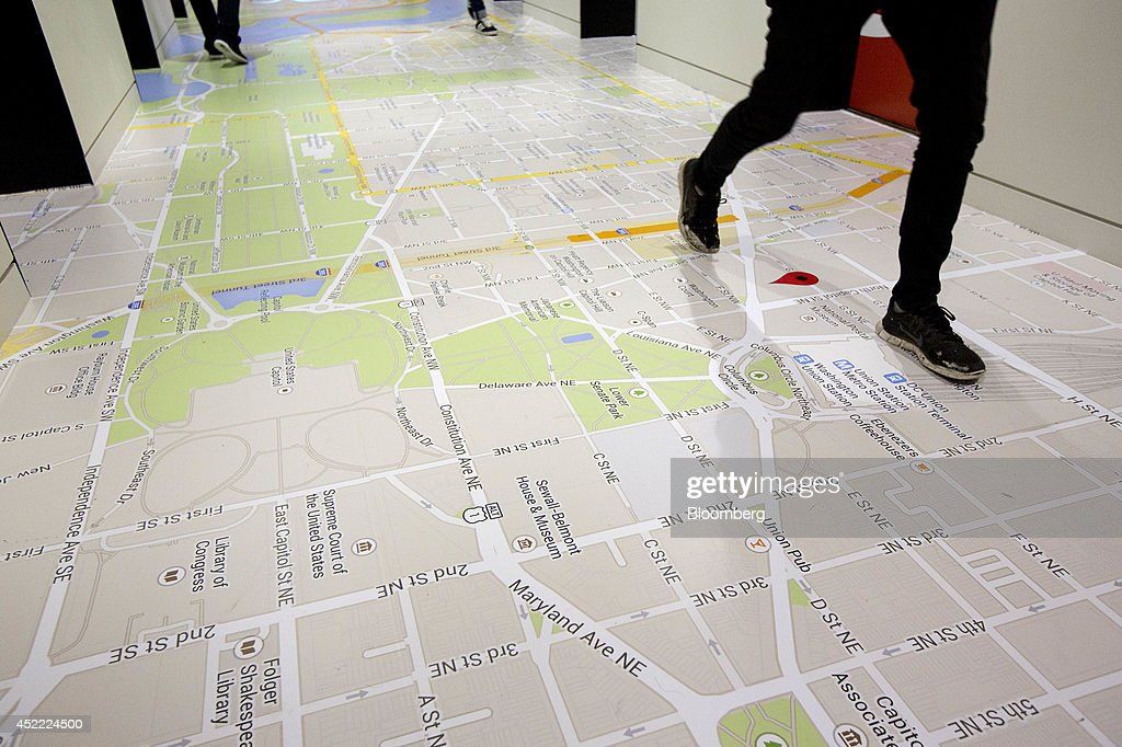 A Google Inc. Maps display of Washington D.C. lines the floor next to the elevators at the Google office in Washington, D.C., U.S., on Tuesday, July 15, 2014. Google's presence in Washington is necessitated in part by the Federal Trade Commission and U.S. Justice Department inquiries into how the company obtains and uses private data. Additional privacy and safety concerns are likely to arise from Google projects in the works, including nose-mounted Google Glass computers and self-driving cars. Photographer: Andrew Harrer/Bloomberg via Getty Images