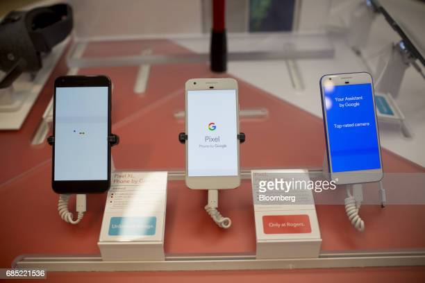 Google Inc Pixel smartphones sit on display inside a Rogers Communications Inc store in Toronto Ontario Canada on Wednesday May 17 2017 Rogers...